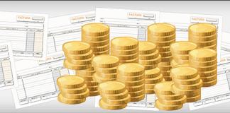 Facturas dibujadas y unas monedas