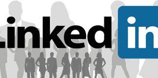 Logo de Linkedin sobre una imagen de siluetas de personal de negocios