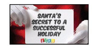 """Manos de Santa Claus sujetando un cartel zoho con texto """"Secret to a succesful holiday"""""""