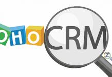 logo de Zoho CRM y una lupa