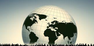 dibujo de el planeta tierra y las siluetas de muchas personas