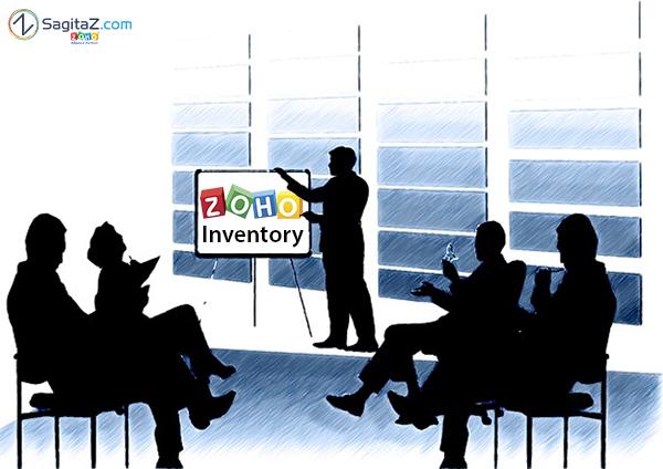 siluetas de personas en una oficina asistiendo a una presentacion de zoho inventory