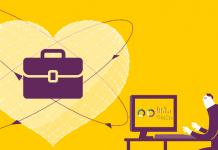 dibujo corazon con un maletin dentro moradado y un hombre al lado trabajando con un ordenador